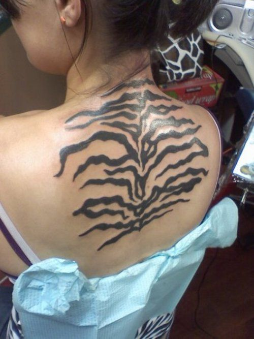 Amazing Zebra Print Tattoos Ideas and Designs