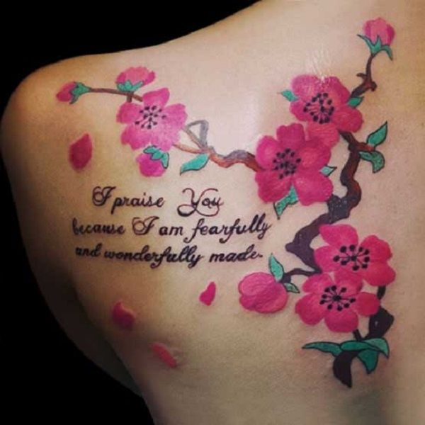 Wonderful looking cherry blossom tattoo on the shoulder with quotes. Cherry blossom designs are also a great way to frame quotes, lyrics and words on the tattoo and they work very well with each other.