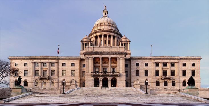 The Rhode Island State House is the capitol of the U.S. state of Rhode Island. It is located on the border of the Downtown and Smith Hill sections of the state capital city of Providence. The State House is a neoclassical building that houses the Rhode Island General Assembly and the offices of the governor of Rhode Island as well as the lieutenant governor, secretary of state, and General Treasurer of Rhode Island. The building is on the National Register of Historic Places.