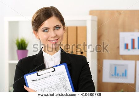 Beautiful female accountant hold income tax return form portrait. Internal Revenue Service inspector checking financial document, 1040, planning budget, certified public accountant concept