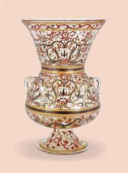 AN ENAMELLED GLASS MOSQUE LAMP -   LATE 19TH CENTURY, POSSIBLY FRANCE -   Enamelled in red, white and black, and outlined in gilt in the Islamic style  14 7/8 in. (37.8 cm.) high