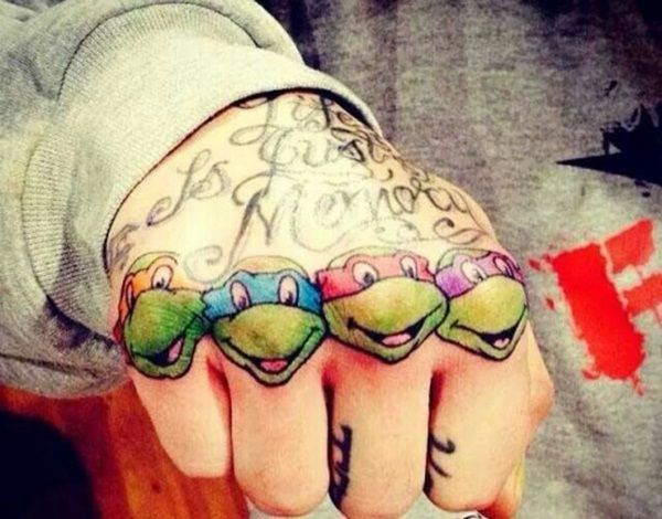 When you tattoo the vintage, 80's Teenage Mutant Ninja Turtles on your knuckles, Donatello, Raphael, Leonardo, and Michelangelo are there to help you beat the bad guys, everywhere you go!