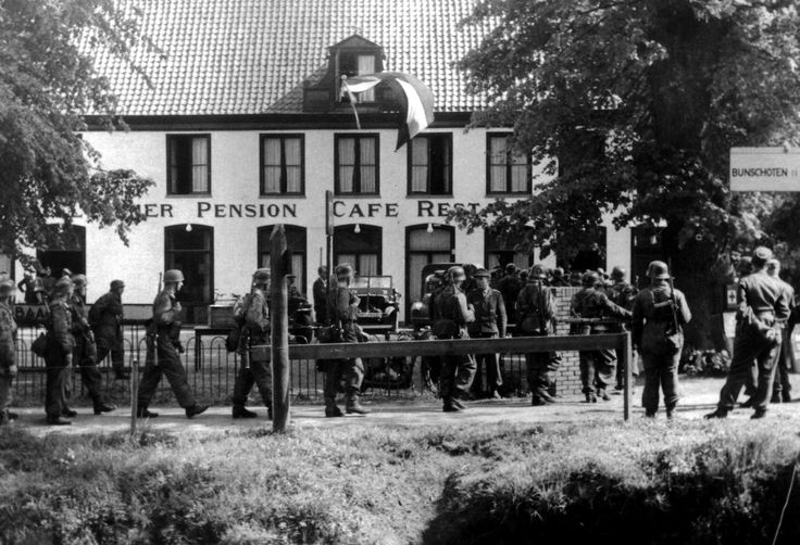 German paratroopers of the 6th Parachute Division (6. Fallschirmjäger-Division) head to the Dutch restaurant and hotel Trier for drinks and a meal before surrendering to British forces. Soestdijk, Utrecht, Netherlands. 5 May 1945. Image taken by...