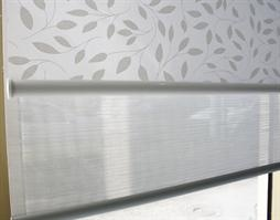 Hunter Douglas Chatsworth light filtering fabric for master bedroom blind, backed by white opaque blind.