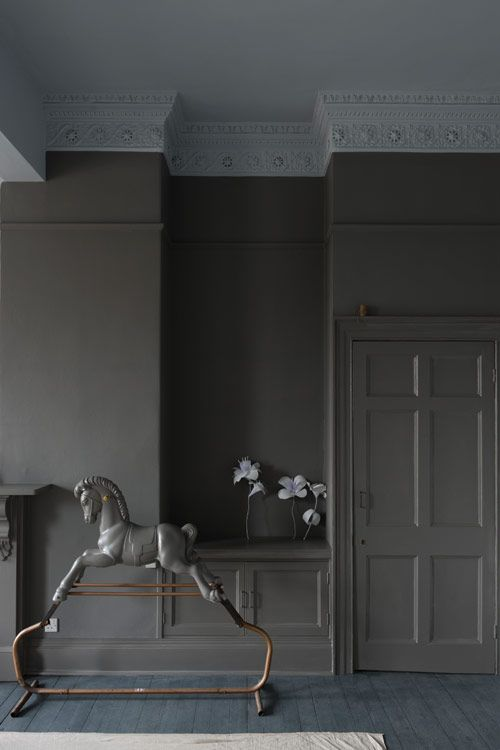 This photo shows a wall with the door and trim painted the same color like we talked about on your upstairs landing.   greige: interior design ideas and inspiration for the transitional home : mole's breath farrow and ball...