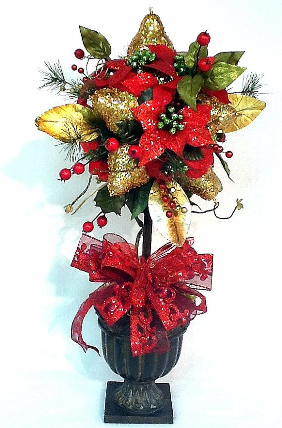 Christmas Holiday Topiary floral Centerpiece Pears & Poinsettias in red, lime, and gold $177.00 design by Cabin Cove Creations ... If sold stop by the cabin and check out all my other unique designs :) ... Click here ...  http://www.etsy.com/shop/cabincovecreations?ref=si_shop