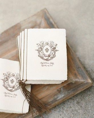 Wedding programs letterpressed with an antique Italian crest and bound with waxed cord