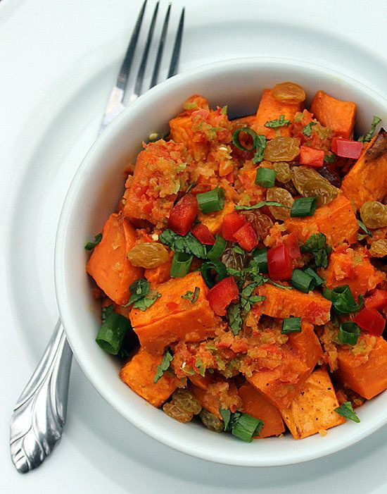 I'm totally bringing this spicy sweet potato salad to my next BBQ. Looks easy to make and love the golden raisins.