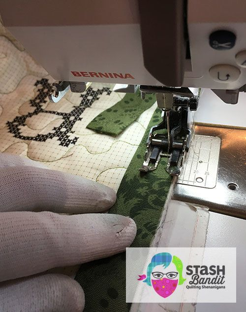 Many years ago, a quilt shop owner showed me her technique for binding a quilt by machine. I've used it ever since because it looks great on the front and the back of the quilt, it's easy, it's fast and it's sturdy. Here's a tutorial for how I bind my quilts by machine. Trim the backing and batting even with the edge of the quilt top as you normally would. Cut enough 2.25-wide binding strips to go around the quilt. Join the strips end to end with diagonal seams. ...