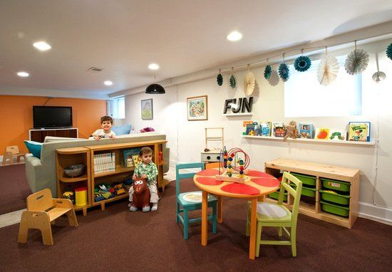 kids play space, basement family room, bookshelf and toy organizers, bright furniture with orange accent wall in tv area, brown rugs to tie it all together  | followpics.co