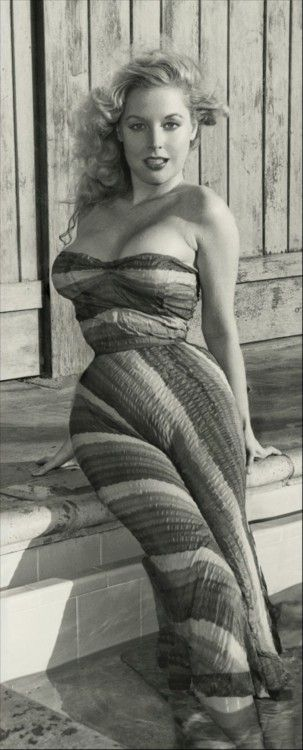 Betty Brosmer....who says size 2 is beautiful?? Now these are the curves of a REAL woman!!