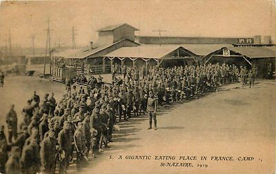 St Nazaire France 1919 WWI US Troops Giant Mess Hall Antique Vintage Postcard St. Nazaire France 1919 American troops line up for mess hall where 5,000 troops can be fed every twenty minutes. Unused c