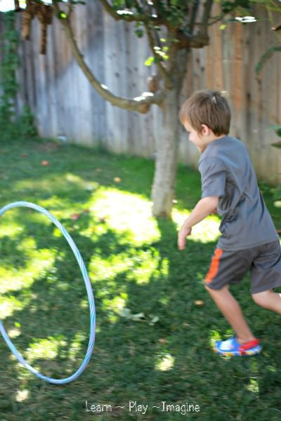 {Hula Hoop Games} Roll the hoop, then try to run past it before it falls over