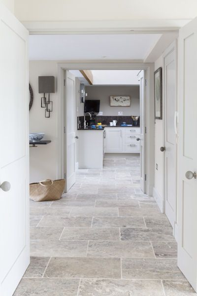 Silver Tumbled Travertine! also like simple door frame: