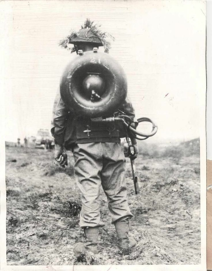 "1944- British Commando carries the machinery of a ""Life Buoy"" flame thrower on his back somewhere in France."