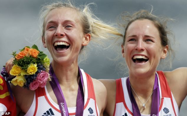 Emotional moment: Katherine Copeland (left) and Sophie Hosking stand on the podium after winning the gold medal in the Women's Double Scull