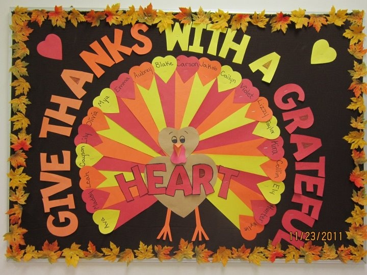 """""""Give Thanks With a Grateful Heart"""" is a lovely title for a Thanksgiving bulletin board display.  I love how the teacher wrote her students' names inside the hearts, which are the tail section of the colorful turkey that she designed. This is so cute! Would take a lot of prep, but is very cute!"""