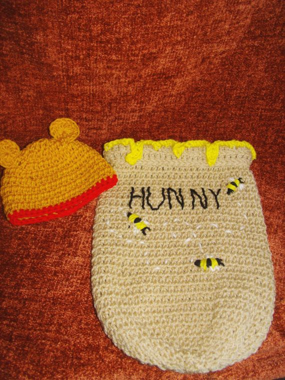 Swaddle your cuddly little bear in this adorable hunny pot. Comes with Pooh bear hat to keep your little bear nice and warm. This one of a kind swaddler is perfect for baby shower gift or and adorable photo prop. Makes for a warm and sweet as honey baby costume for Halloween! Fits Newborn READY TO SHIP Machine wash and dry Created in a smoke free home Shipped Flat rate Priority Mail (2-3 days) USPS
