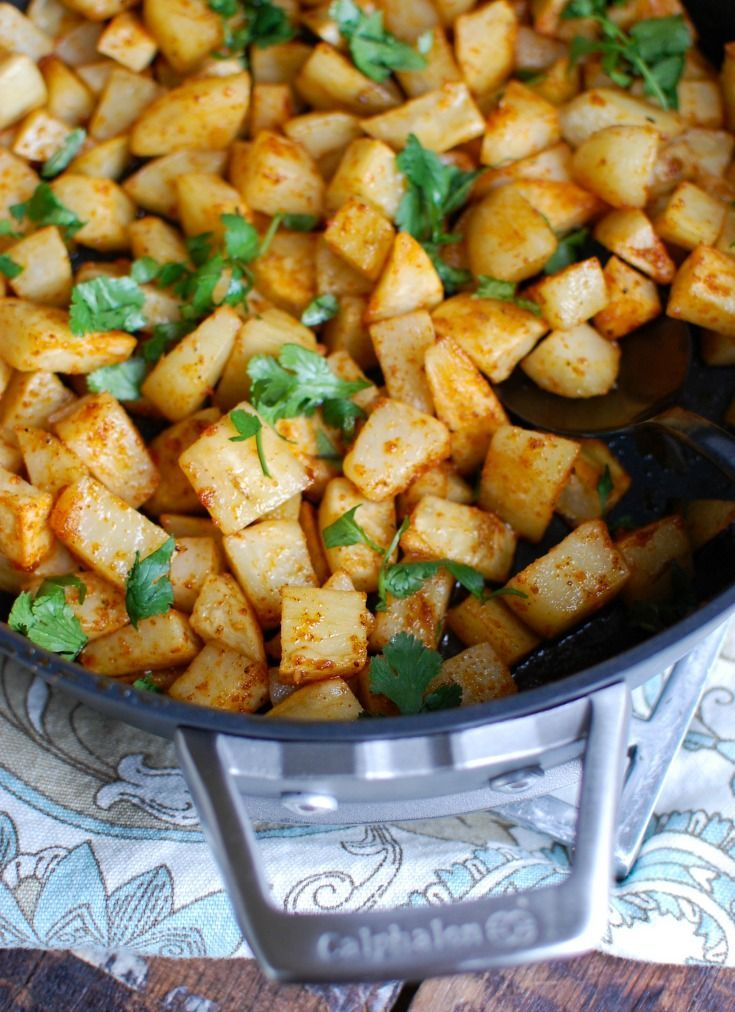 Spicy Lebanese Potatoes are crisp on the outside, tender on the inside and will spice up any meal. The sauce on these potatoes is the star featuring coriander, paprika, cayenne pepper mixed with olive oil and lemon juice. The dish is finished off with your favorite herb, cilantro or parsley. // #potatoes #sidedish #Lebanese #Lebanesepotaotes #spicy #food #recipe #vegetarian #cilantro #limejuice #coriander #cayennepepper #garlic #dinner #Mediterraneandiet #Mediterraneanfood #Middleeasternfood