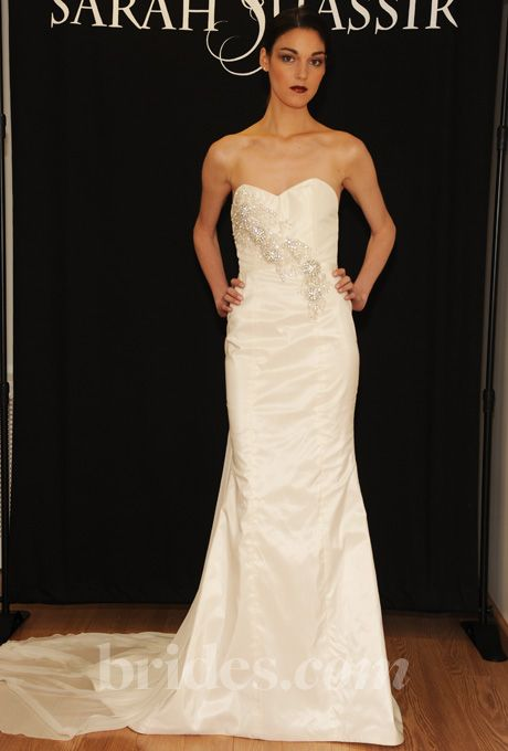 Brides.com: Sarah Jassir - Fall 2013. Strapless satin sheath wedding dress with a sweetheart neckline and beaded details over bodice, Sarah Jassir  See more Sarah Jassir wedding dresses in our gallery.