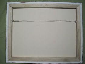 How to install a wire into a canvas for hanging.