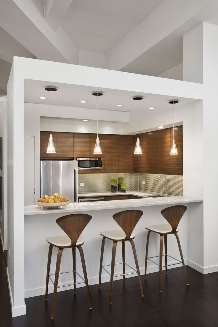 These hanging lights and organic wood, cushioned stools would add an earthy and modern feel to any #HeraldTowers kitchen!