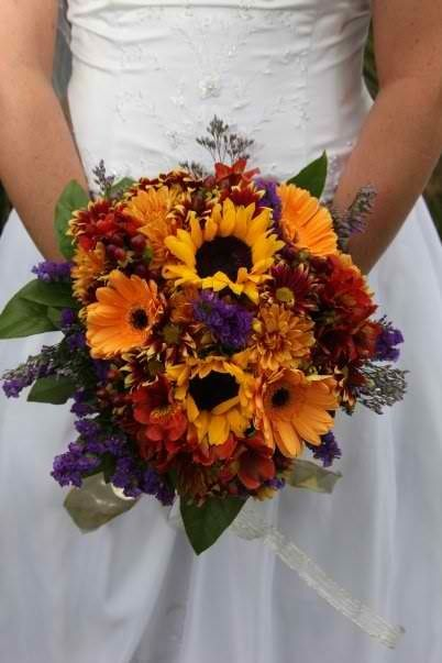 Love this bouqet! Perfect mix of yellows, oranges, reds, and purples! I want this
