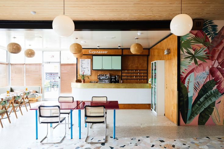 A Revived Midcentury Motel in New Orleans With Serious Flair - Photo 3 of 11 - The lobby and reception space is adorned with retro pendant lighting, tropical Ralph Lauren wall graphics, and colorful furnishings.