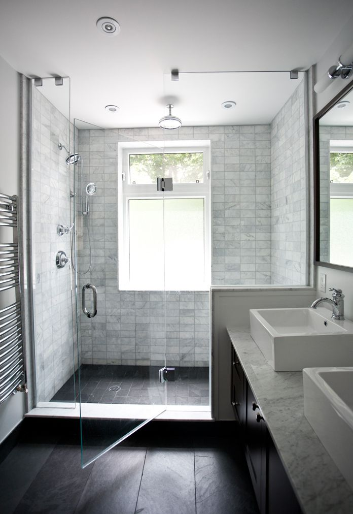 Marble shower tiles with black floor tile Sarah Pierce