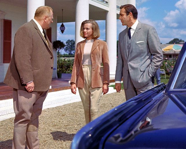 Auric Goldfinger (Gert Fröbe), Pussy Galore (Honor Blackman), and James Bond (Sean Connery) get acquainted in Goldfinger. 1964. Great Britain. Directed by Guy Hamilton. Image courtesy Photofest