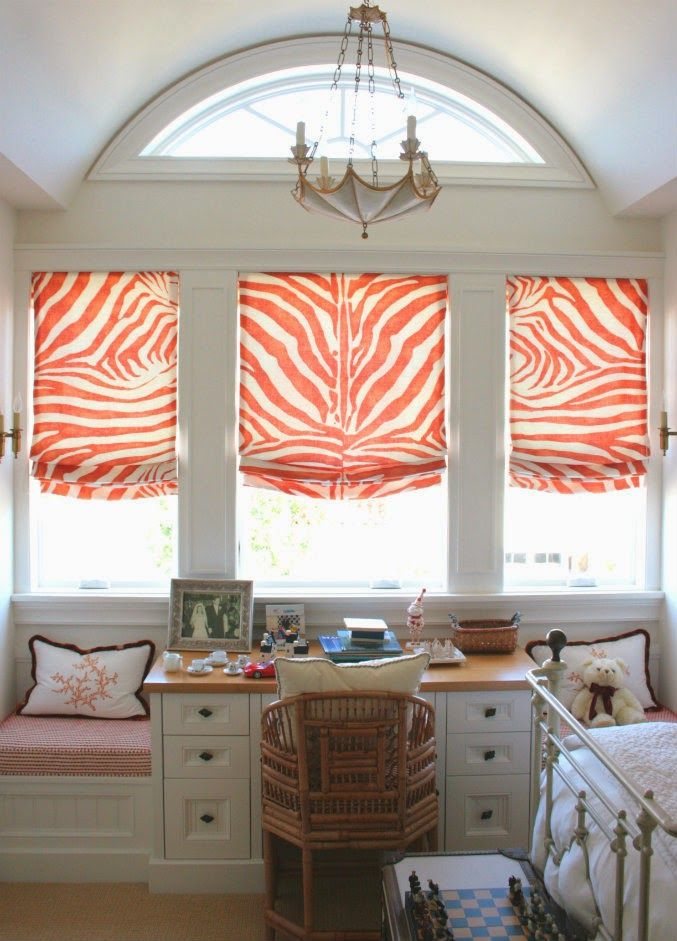 My favorite room is the guest room with the fun orange zebra-striped window shades, but the whole house is just amazing!