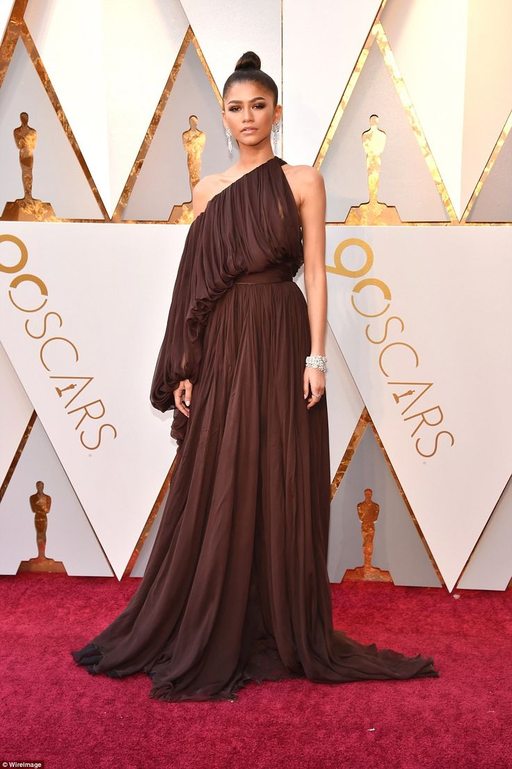 A goddess: Zendaya chose a chocolate hued one-shoulder gown with a pleated texture; she wore her locks in a top knot