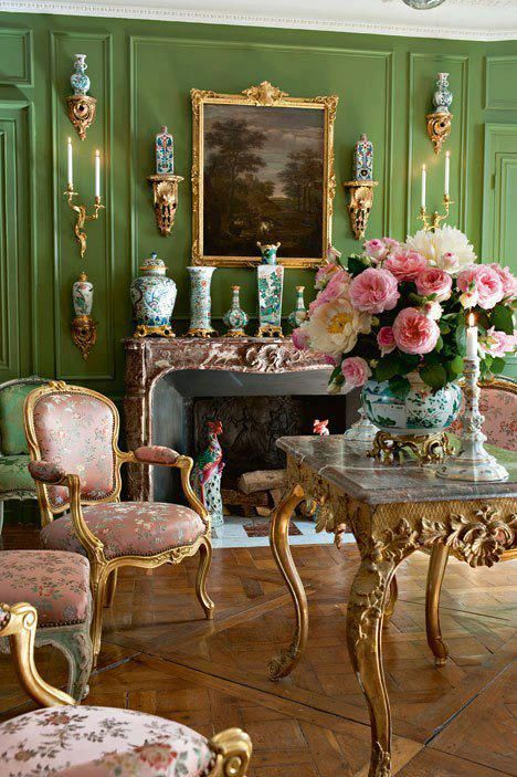 Gorgeous grassy green walls in this Parisian sitting room are highlighted by gilt accessories, a beautiful collection of Chinese porcelain, and fluffy pink blooms. And how do you not love a parquet de Versailles floor?