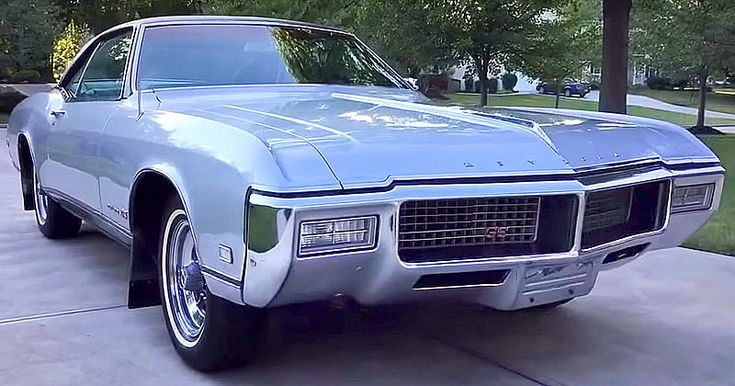 This is a 1968 Buick Riviera GS 2-door Sport Coupe Hardtop in Inca Silver Mist and black vinyl interior. 430 cubic inch V8 with 3-speed ST-400 automatic