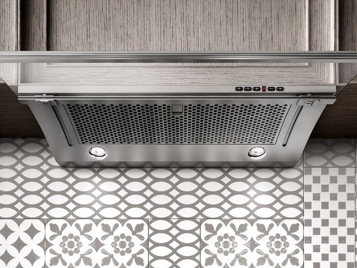 The curved glass surface of the Glide hood captures easily more fumes. You can also slide it in when not in use.