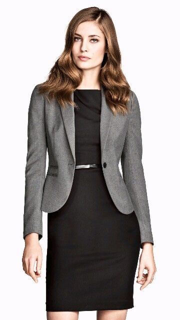Black dress or skirt and top with a grey jacket.