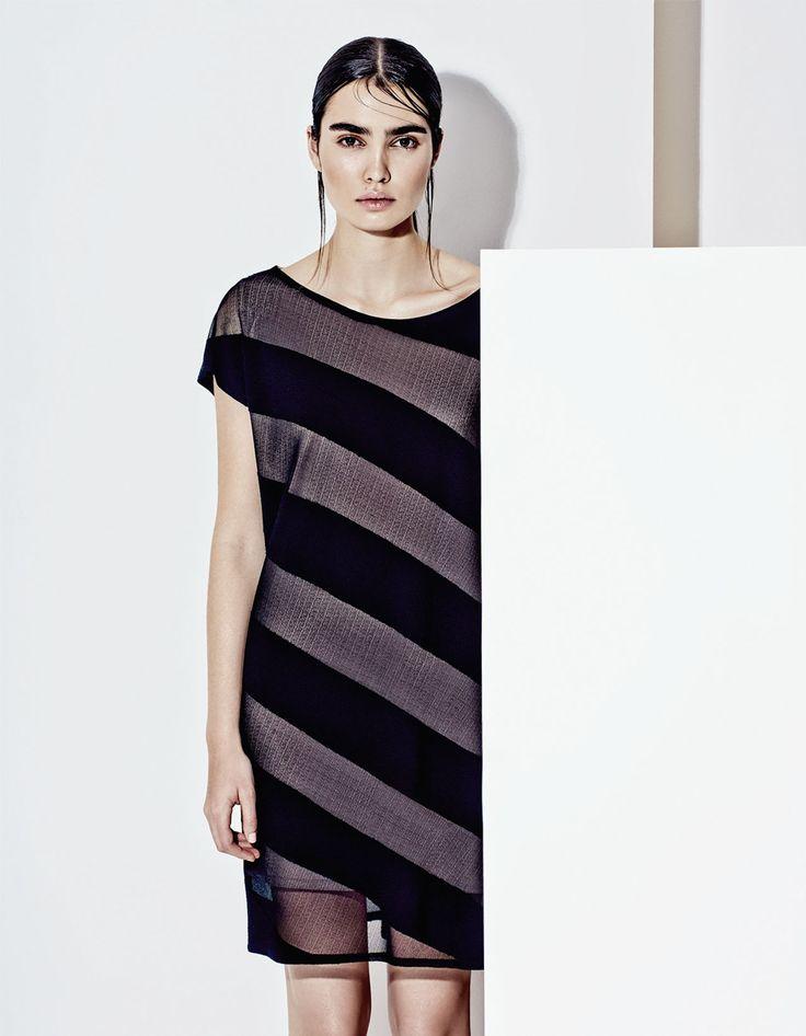 Elegant semi trasparent black mini dress, futuristic style