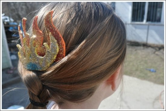 > A Hunger Games DIY  1. Cut shapes out of foam  2. Brush glue and glitter onto shapes and let dry  3. Attatch to a hair comb