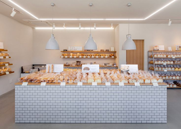 Maybe future route for me? ho ho ho - Renovated Japanese bakery featuring tiled walls and oak shelving.