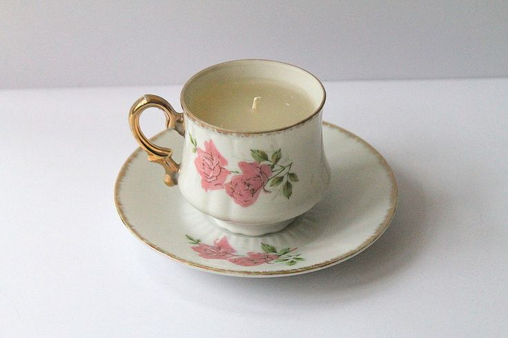 Candle in teacup, white tea and ginger.