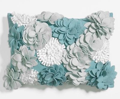 Winter Bloomburst Pillow A garden of felt flowers bursts into bloom on this lively Winter Bloomburst Pillow. Measures 14″W x 20″L. $78.