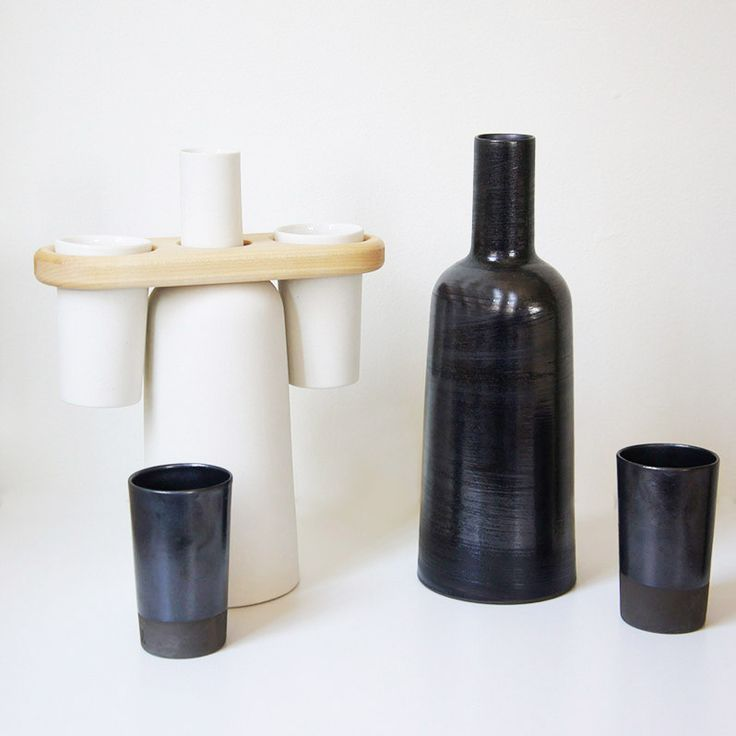 Black and White Ceramic bottle and cups. The wooden saddle allows the bottle and two cups to be carried in one hand