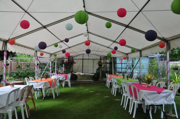 A simple unlined marquee can look very pretty with a few paper lanterns, ribbon and colourful cloths
