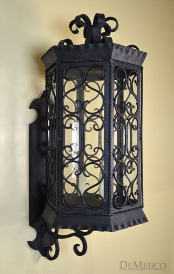 29 best outdoor lighting images on pinterest wall mount the tlaquepaque wall mount is a large and beautiful hand forged spanish wall mount finished in a weathered black and held up on a simple back plate aloadofball Images