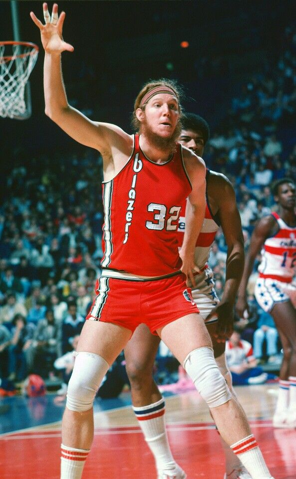 Bill Walton guarded by Wes Unseld.