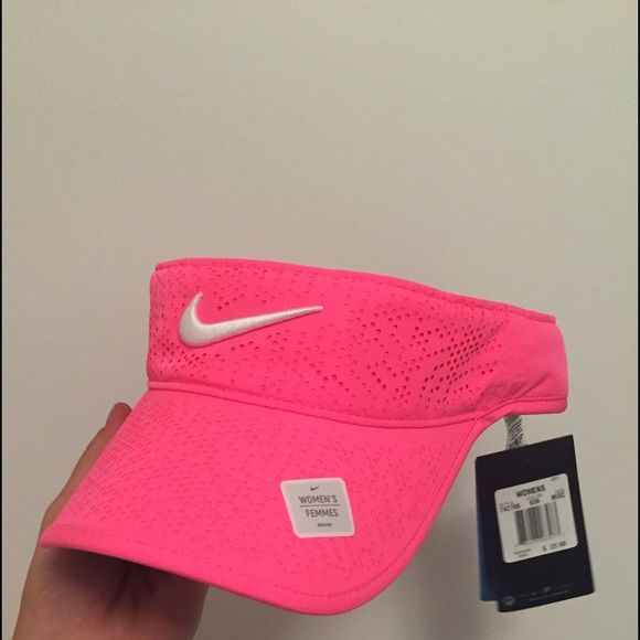 Women's Nike Hot Pink Visor Never been worn Nike visor. Adjustable strap in the back, tags still attached. Nike Accessories Hats