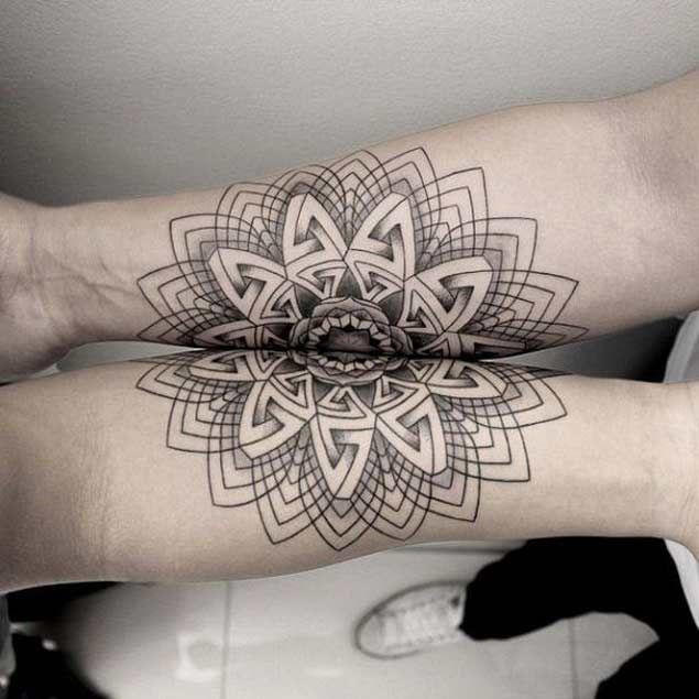 Symmetric Tattoos on forearm