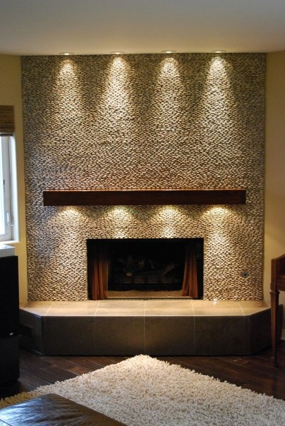 fireplace mantel lighting. no so much the mantle lighting but love puck lights shining down on fireplace facade mantel t