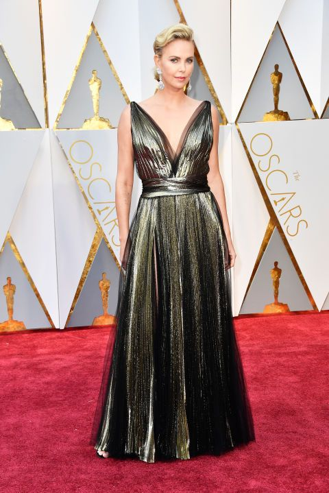 Charlize Theron was a literal glowing goddess in a metallic Dior gown andChopard jewels.