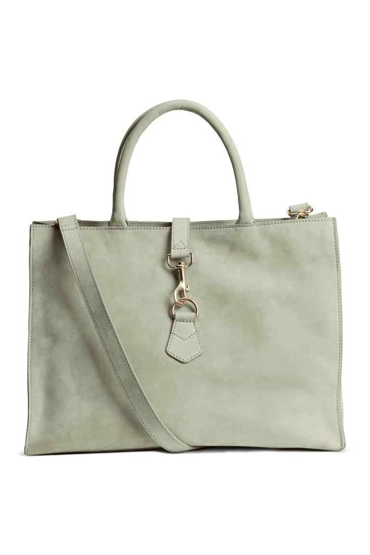 Leather handbag: PREMIUM QUALITY. Leather handbag with two handles at the top, a detachable shoulder strap, a carabiner hook fastener and zip at the top, and three inner compartments, one with a zip. Lined. Size 16.5x29x39 cm.